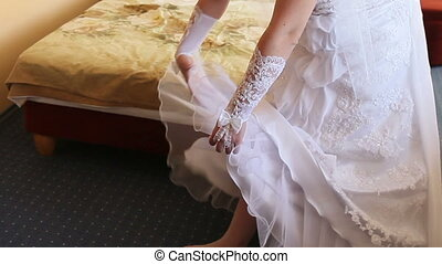 bride corrects dress - beautiful bride corrects her white...