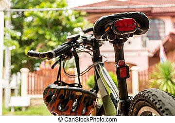 Red bicycle rear lamp with Mountain Bike