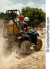 Couple riding quad bike - Off road quad bike racers