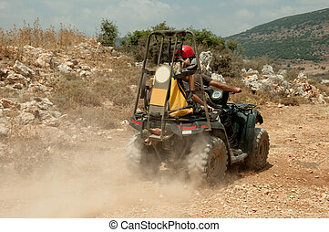 Sportsman riding quad bike at extreme - An offroader...