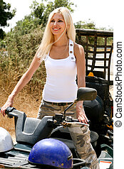 Beautiful lady on all terrain vehicle - Portrait of a...