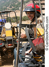 Young woman riding atv - Lady with helmet having fun ride on...