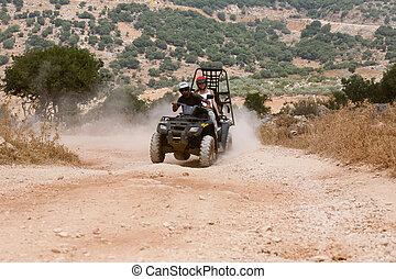 Atv action - Young couple having fun on atv