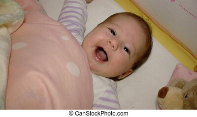 Baby smiling in crib