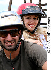 Close-up of smiling couple - Couple wearing safety helmet...