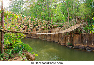 bamboo bridge over the river in Tad Pha Souam Waterfall at Paksa