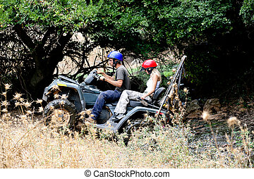 ATV climbing high - ATV climbing with lush green background