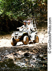 Quad couple on a dirt road - Couple riding through dirt and...