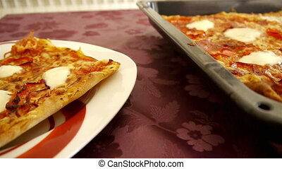 Home made pizza motion view - Home made pizza on table...