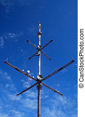 television tower on a background of the blue sky and rare...