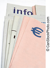 euro symbol on Stacked newspapers