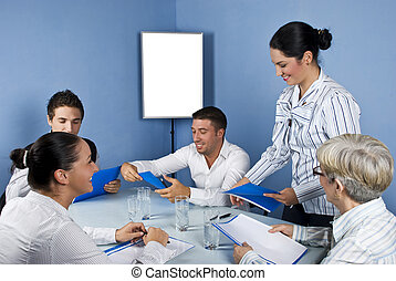 Group of business people in middle of meeting - Meeting with...