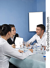 Group of people talking at meeting