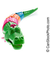 Wind up crocodile toys on white background