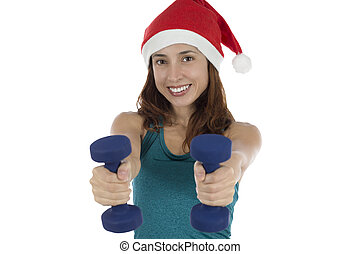 Young Christmas fitness woman with dumbells doing fitness -...
