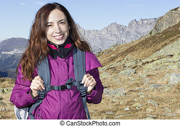 Young woman on a hiking trip in autumn on mountains