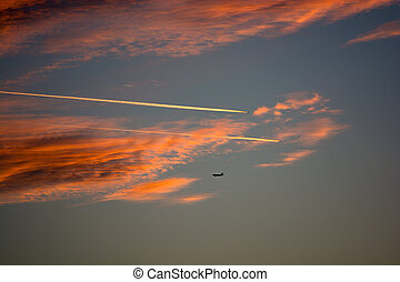 Cloudy Evening Sky With Airplanes
