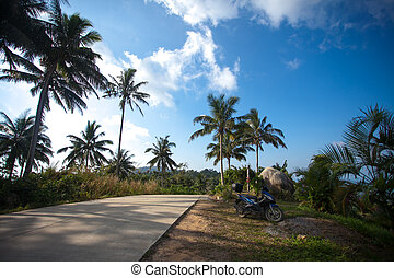 Motorcycle at road on top mountains of Koh Samui Thailand