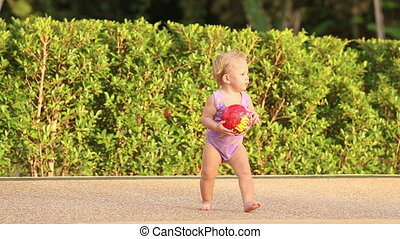 one year baby girl - one year girl child throws a ball in...