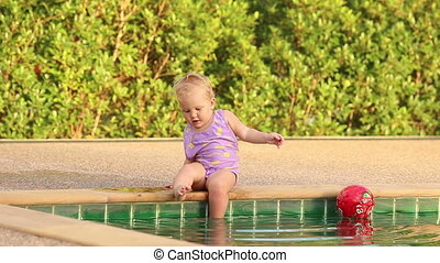 one year baby girl - one year girl child gets into the pool...