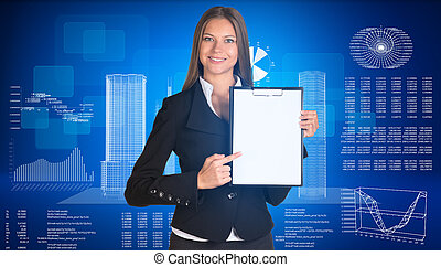 Businesswoman holding paper holde. Wire-frame buildings and...