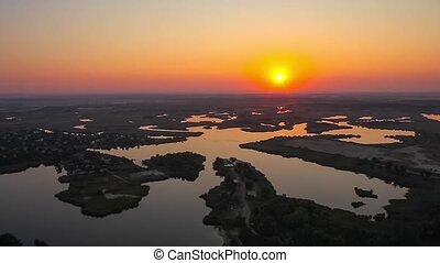 Sunrise over the lake and islands. Aerial shot. Ukraine,...