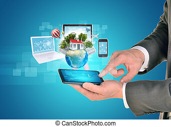 Man hands using smart phone Earth with house and electronics...