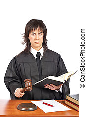 Verdict - A female judge in a courtroom striking the gavel....