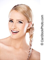 Attractive blond woman with her hair in a braid posing with...