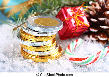 Christmas composition with stacked chocolate euro coins on...