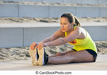 Woman stretching and touching her toes