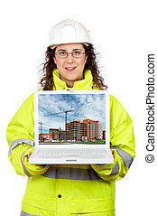 Showing a building construction on the laptop