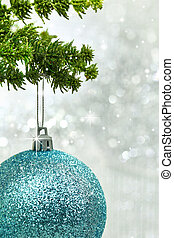 Christmas blue ball hanging from a branch