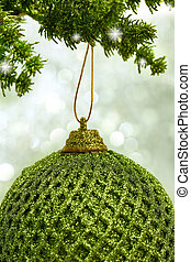 Christmas green ball hanging from a branch