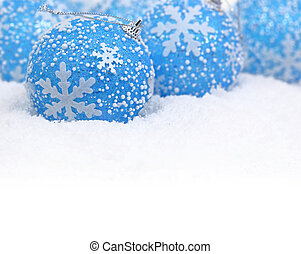 Christmas blue balls on the snow