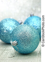 Christmas blue balls in a brightly background