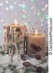 Winter candles on a grey background
