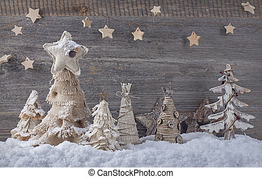 Christmas trees - Christmas homemade trees on a wooden...