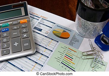 Budgeting - Budget on a wooden desk with a calculator,...