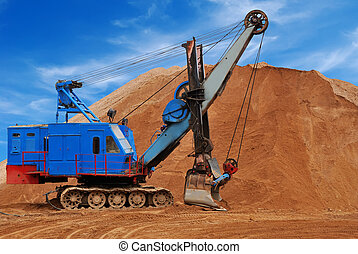 Heavy electric excavator in sandpit - Heavy digger electric...