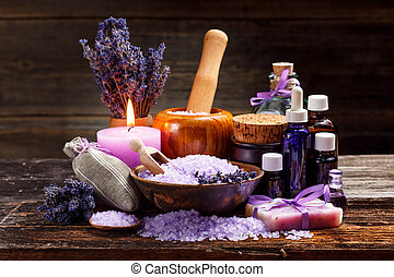 Lavender bath items on wooden background