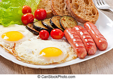 English breakfast - fried eggs, sausages, eggplant and...