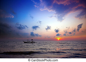 Longtail boats and sunset. Khao Lak, Thailand.