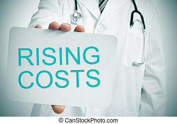 medical rising costs - a doctor showing a signboard with the...