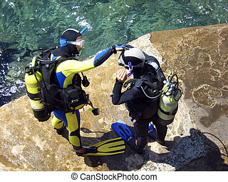 Scuba Divers - two men prepare for diving