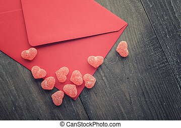 Valentines day concept - Red envelope with jelly candy in...