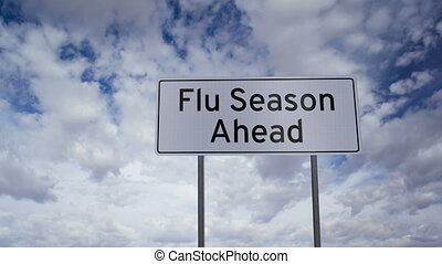 Flu Season Ahead Sign Timelapse - A road sign that indicates...