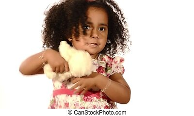 brazilian child with her soft toy - funny mixed race black...