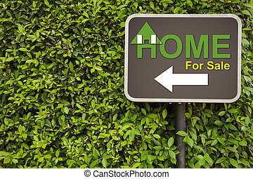 Home sign - Home for sale sign on green leaves wall