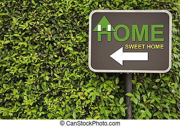 Home sign - Home sweet home sign on green leaves wall